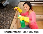 Smiling Brunette Cleaning...