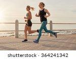 two young women running along a ... | Shutterstock . vector #364241342