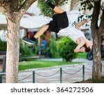 Small photo of Young athlete doing extreme acrobatics outdoor