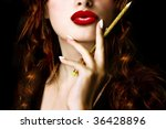 Pretty woman holding a pencil - stock photo