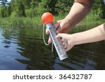thermometer in front of water   Shutterstock . vector #36432787