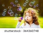Little Girl Blowing Soap...