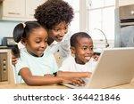 happy family using laptop in... | Shutterstock . vector #364421846