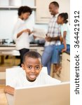 son using laptop against... | Shutterstock . vector #364421912