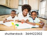 mother helping children do... | Shutterstock . vector #364422302