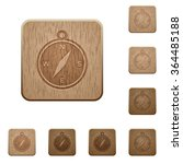 set of carved wooden compass...