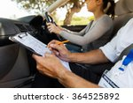 driving instructor inside a car ... | Shutterstock . vector #364525892