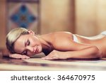 young woman lying on hammam... | Shutterstock . vector #364670975