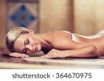 young woman lying on hammam... | Shutterstock . vector #364670975