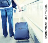 traveler with a suitcase on the ... | Shutterstock . vector #364740686