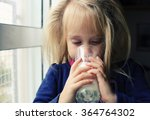 5 years old girl holding glass... | Shutterstock . vector #364764302