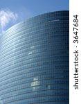 Blue Sky & Corporate Glass Building. - stock photo