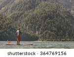 woman paddle boarding on a calm ... | Shutterstock . vector #364769156