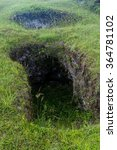 Small photo of Entrance to the ancient tomb located in El Aguacate site in Tierradentro, Colombia