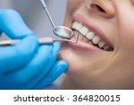 Dentist examining a patient's...