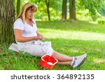 50 year old woman knitting in... | Shutterstock . vector #364892135