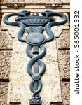 Small photo of old Aesculapian staff - Caduceus at a historic building
