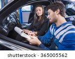 car expert shows the checklist... | Shutterstock . vector #365005562