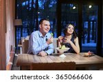 young couple sitting at a table ... | Shutterstock . vector #365066606