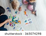 father playing puzzle with...   Shutterstock . vector #365074298