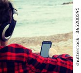 boy sitting down by the beach | Shutterstock . vector #365200295