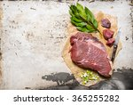 a piece of fresh raw meat with...