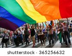 Small photo of BELGRADE, SERBIA - SEPTEMBER 20:People hold a huge rainbow flag at Gay Pride parade 2015 in Belgrade
