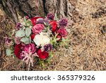 rustic wedding bouquet of red...
