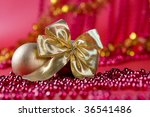 gold ribbon on red background | Shutterstock . vector #36541486