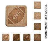 set of carved wooden rugby ball ...