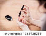 close up of woman hands testing ... | Shutterstock . vector #365428256