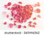 Stock photo heart shape of pink rose petals on wood board 365446562