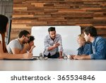 brainstorming in a boardroom of ... | Shutterstock . vector #365534846