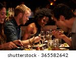 group of friends enjoying meal... | Shutterstock . vector #365582642