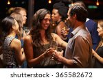 couples dancing and drinking at ... | Shutterstock . vector #365582672