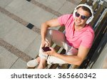 handsome guy on bench | Shutterstock . vector #365660342