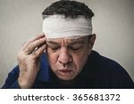 head tied up by bandage | Shutterstock . vector #365681372