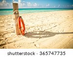 lifesaver beside a trunk on a... | Shutterstock . vector #365747735