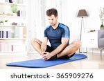 Small photo of Handsome Athletic Man Doing Seated Adductor Stretch Exercise at Home