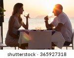 Couple Drinking Wine In Sea...