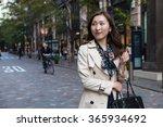 asian woman wearing coat on the ... | Shutterstock . vector #365934692