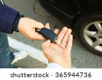 buyer's hand taking a car key. | Shutterstock . vector #365944736