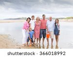 A Family Are On The Beach With...