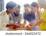 happy business team eating... | Shutterstock . vector #366022472