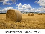 straw bales with river and...