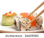 Sushi roll in the chopsticks - stock photo