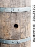 Small photo of Bung hole in old wood cask between metal bands.