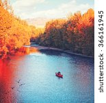 A River Flowing In Autumn Wit...