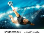 Soccer Player In Action Shoots...