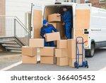 young delivery men unloading... | Shutterstock . vector #366405452